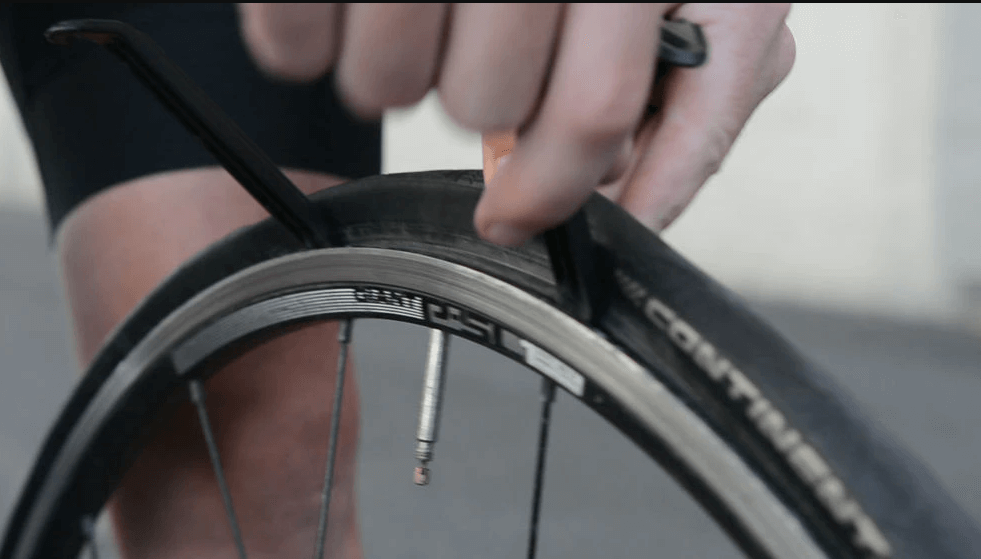 How do I replace a flat tire
